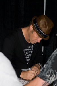 Toby Mac giving an autograph.
